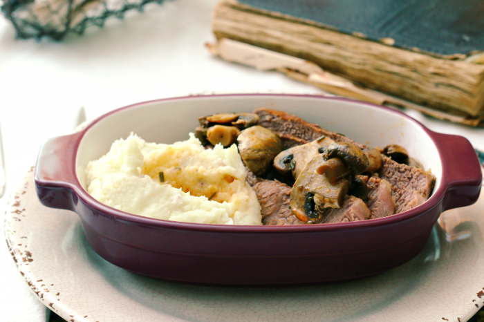 Beef roast in a fresh rosemary and mushroom sauce with homemade mashed potatoes.