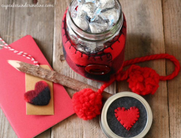 Valentine's Day mason jar filled with kisses - Buffalo check cozy with red pom poms - cupcakesandcrinoline.com