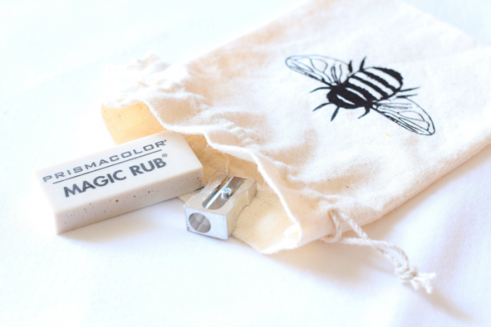 Small muslin bag with eraser and sharpener
