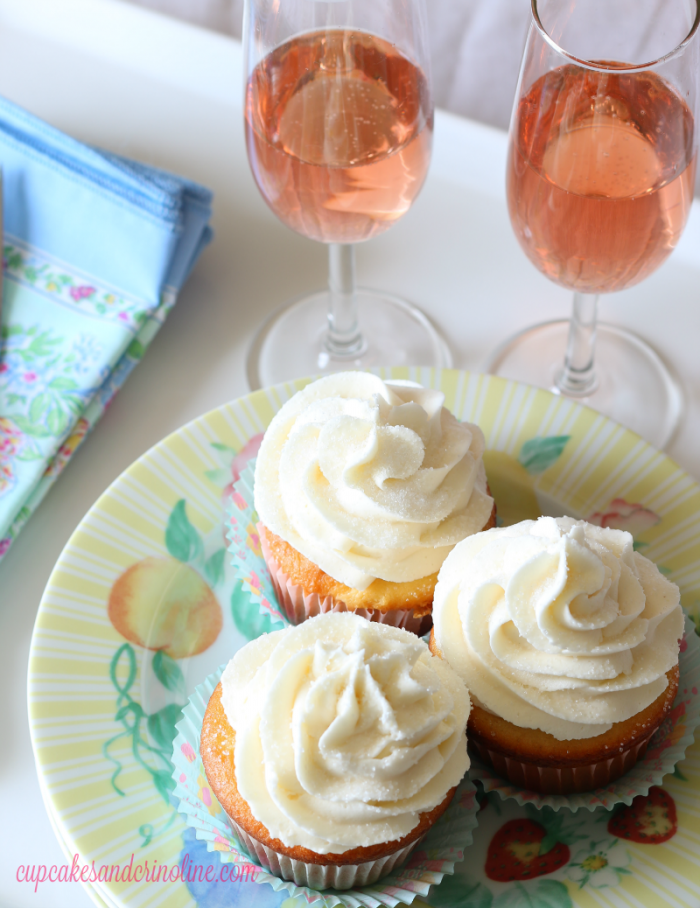 Champagne cupcakes with a champagne buttercream frosting. These are perfect for bridal showers, weddings or a get together with friends. Get the recipe at cupcakesandcrinoline.com