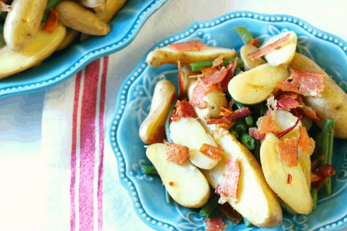 Green beans with bacon, potatoes and a yummy dijon mustard with raw honey dressing at cupcakesandcrinoline.com