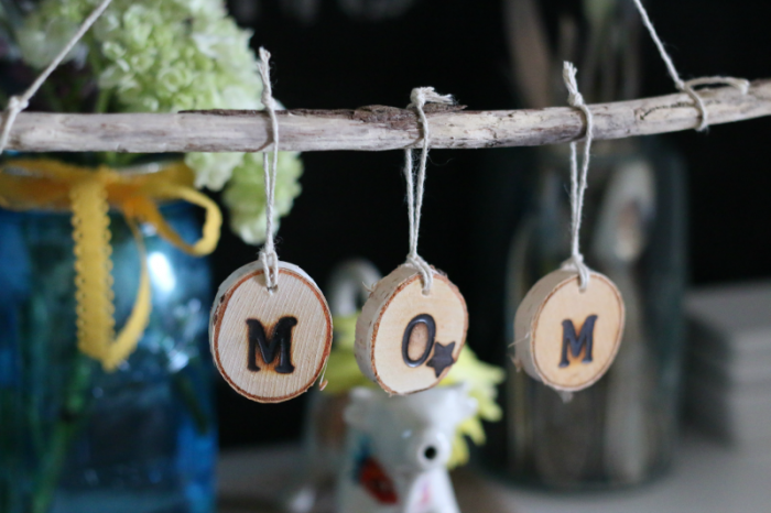 Driftwood and wooden disc hanging sign