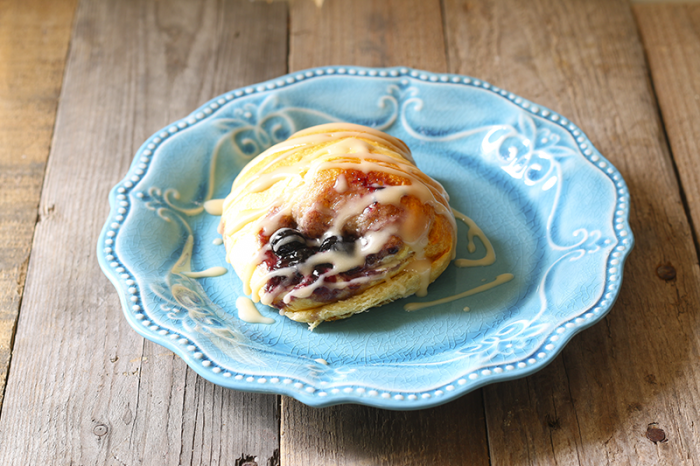 15 Easy Blueberry Cheese Danish with icing on plate
