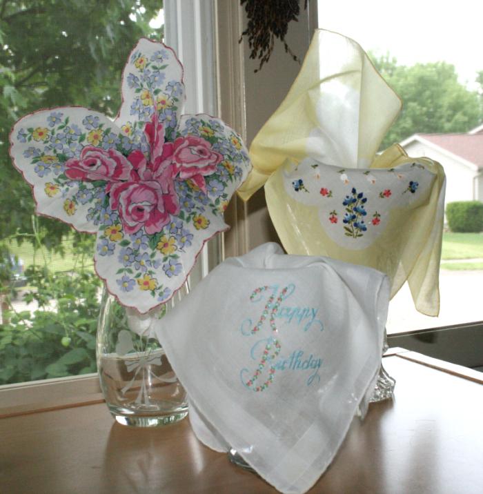 A gardenful of handkerchiefs - vintage handkerchiefs in glass vases