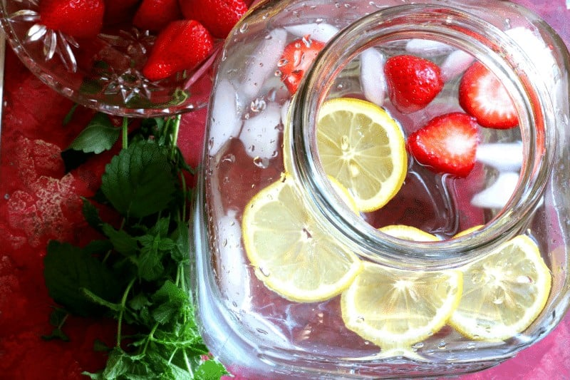 Infused water recipe - strawberries and lemon with mint from cupcakesandcrinoline.com