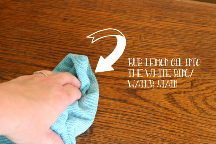 Rubbing Lemon Oil into a water mark on wood