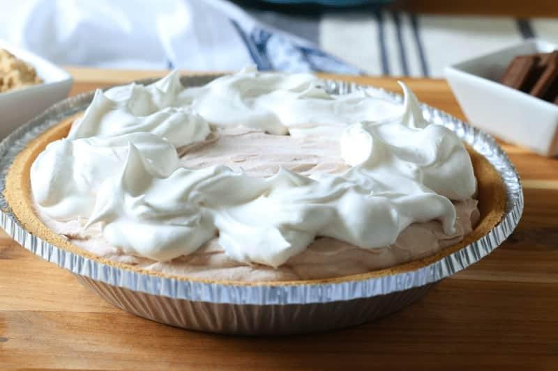 Dollops of whipped cream atop ice cream pie