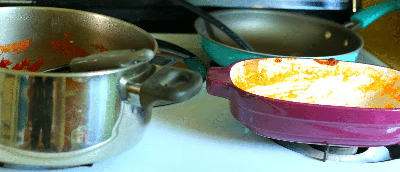 Stovetop of dirty pots, pans and casserole