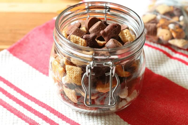 sweet, salty and chocolate snack mix in jar at cupcakesandcrinoline.com