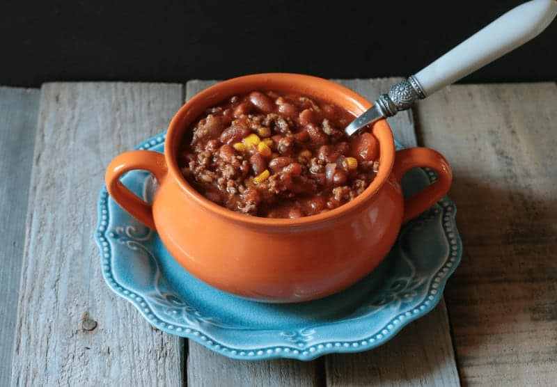 Easy slow cooker chili with meat and beans - at www.cupcakesandcrinoline.com
