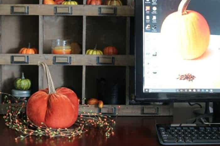 Velvet pumpkin on desk with a pumpkin screen saver. www.cupcakesandcrinoline.com