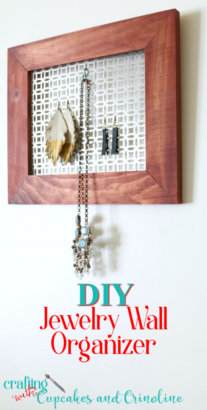 Easy to make for under $10 DIY Jewelry Wall Organizer - get the tutorial at www.cupcakesandcrinoline.com