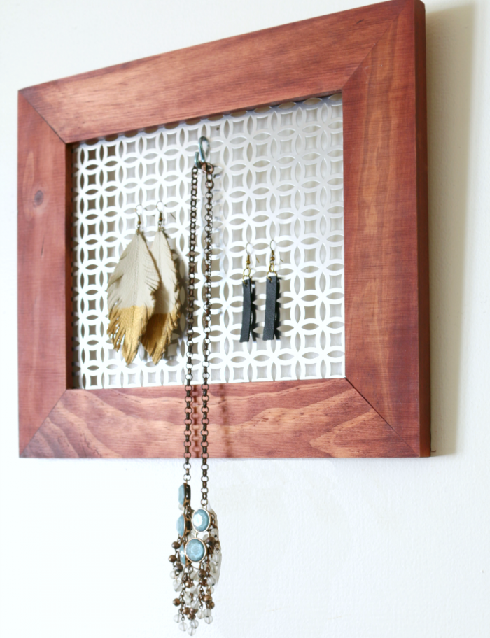 DIY Jewelry Wall organizer on wall with jewelry - get the tutorial at www.cupcakesandcrinoline.com