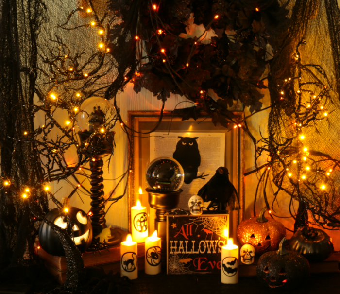 Halloween Decor Explosion with snow globes, flickering candles, glitter pumpkins and more glitter and glam decor at www.cupcakesandcrinoline.com