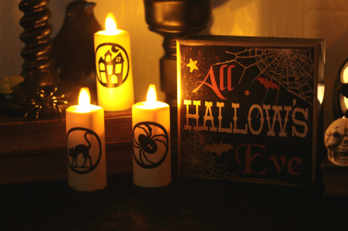 Halloween Decor Miracle Flame Flickering Candles Decorated with Cricut Halloween Vinyl Cutouts