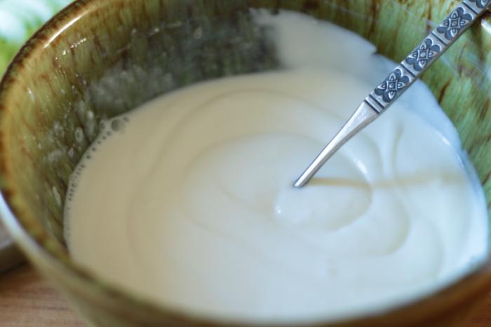 light-sour-cream-vinegar-sugar-and-milk-mixed-in-bowl-sweet-and-sour-cucumber-salad-at-www-cupcakesandcrinoline-com