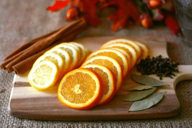 How to make your home smell like the holidays. Easy Slow Cooker Potpourri. Start it simmering in the morning before guests arrive and your house will be filled with the scent of the holidays in no time. Get the details at www.cupcakesandcrinoline.com