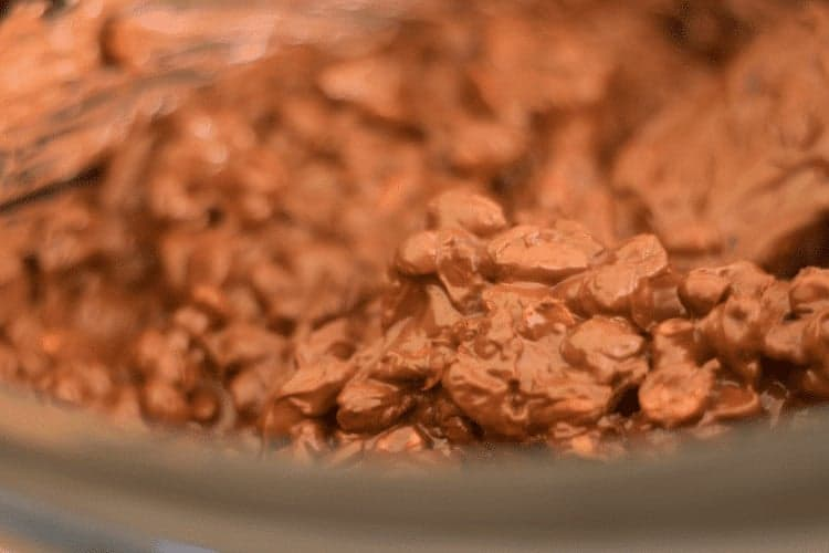 Homemade Slow Cooker Candy. These chocolate-covered peanut clusters taste delicious, can be made up to a month ahead of time and frozen and are perfect for gift giving and holiday entertaining. Get the recipe at www.cupcakesandcrinoline.com