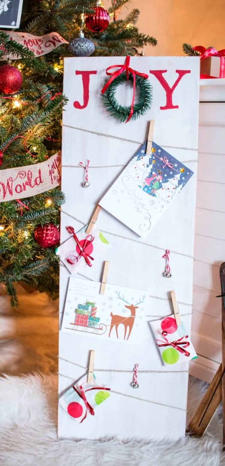 Holiday Card Display. Farmhouse Style Christmas Card and Photo Holder display made from white washed salvaged wood and twine. Get the tutorial at www.cupcakesandcrinoline.com