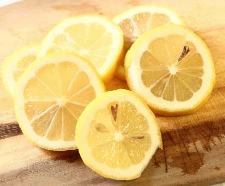 fresh-sliced-lemons-for-honey-lemon-and-ginger-homemade-cough-drops-get-the-recipe-at-www-cupcakesandcrinoline-com