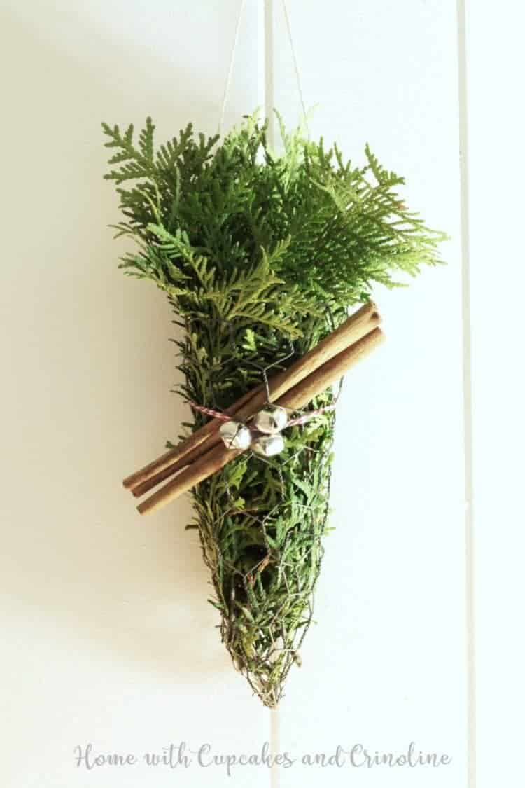 Rustic Evergreen Decor - chicken wire cone with cinnamon sticks and jingle bells.