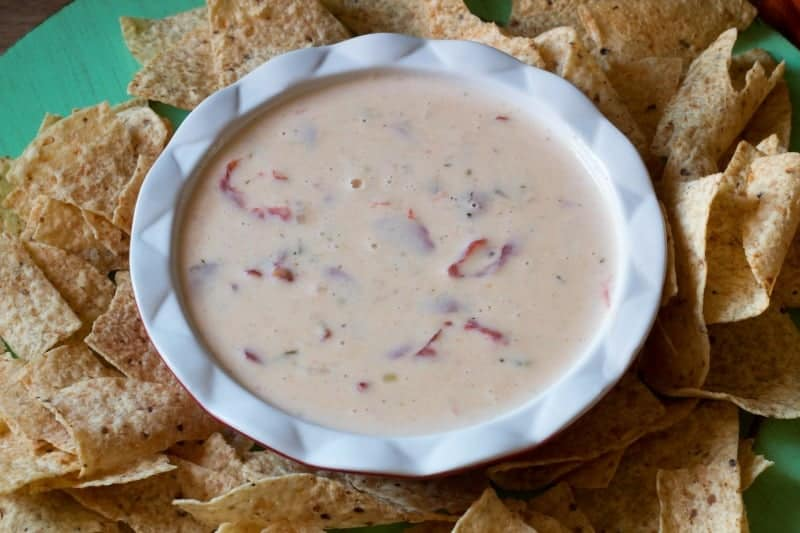 Slow Cooker Queso Blanco made with white American Cheese - can be made ahead and frozen. Creamy and delicious - get the recipe at www.cupcakesandcrinoline.com