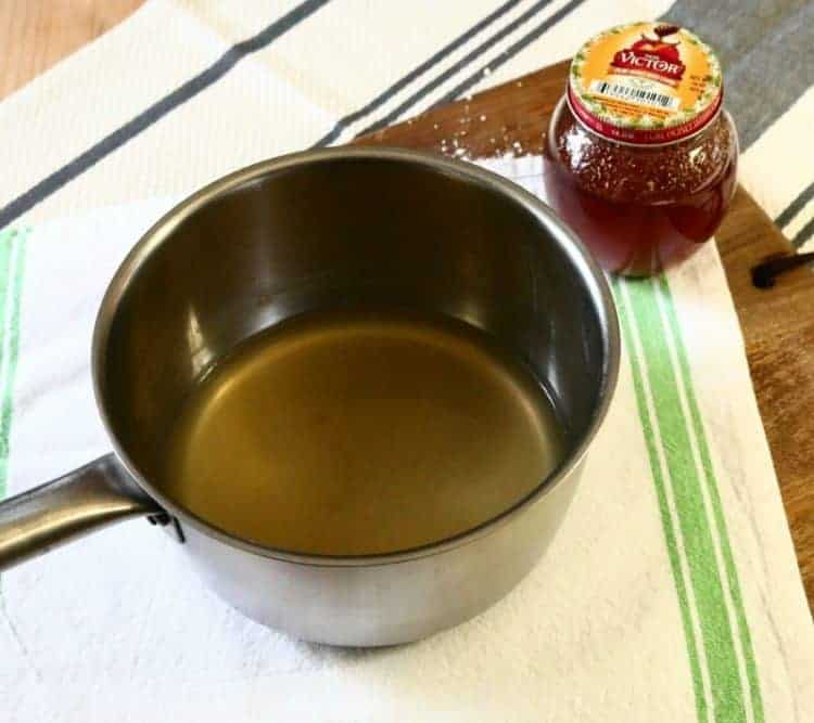 strained-ingredients-for-homemade-honey-lemon-and-ginger-cough-drops-get-the-recipe-at-www-cupcakesandcrinoline-com