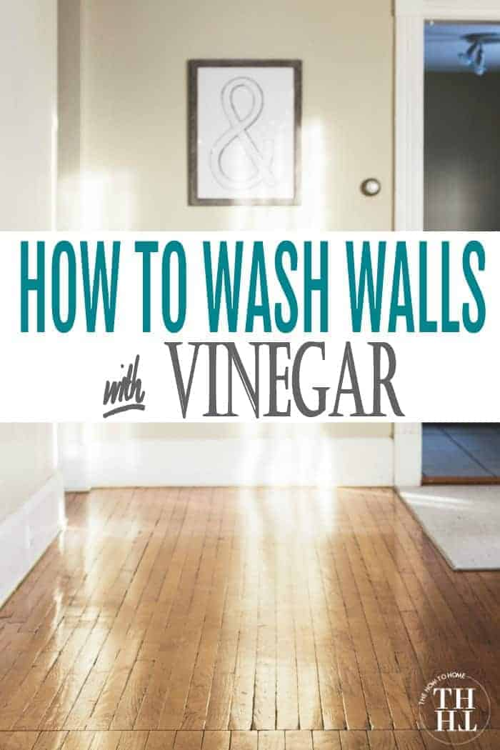 Clean freshly washed walls with white baseboards and a shiny vintage wooden floor