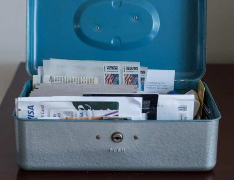 Thrift Store Cash Box with stamps, gift cards and checks inside.