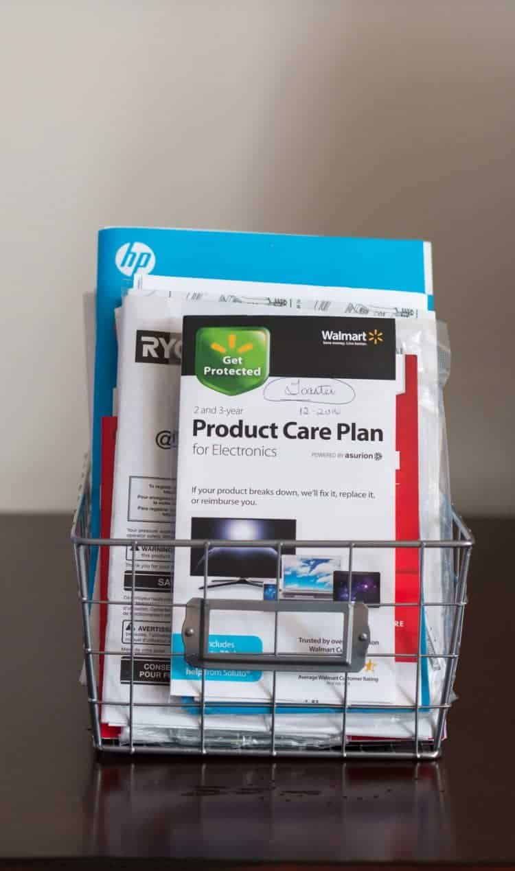 Store warranties and user manuals in small wire baskets.