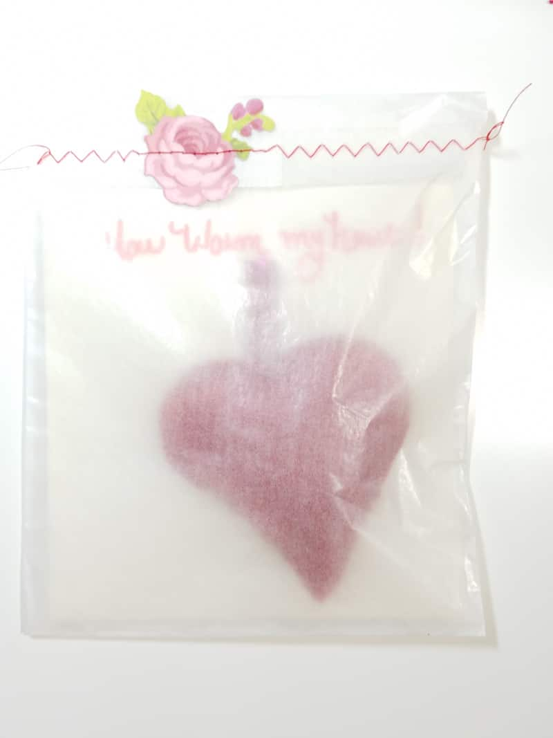 Red Sweater Heart Shaped Hand Warmer Attached to greeting card inside glassine envelope