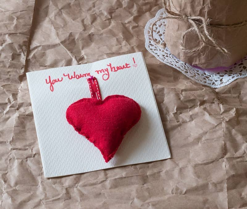 Write sentiments on blank card before adding the sweater hand warmer