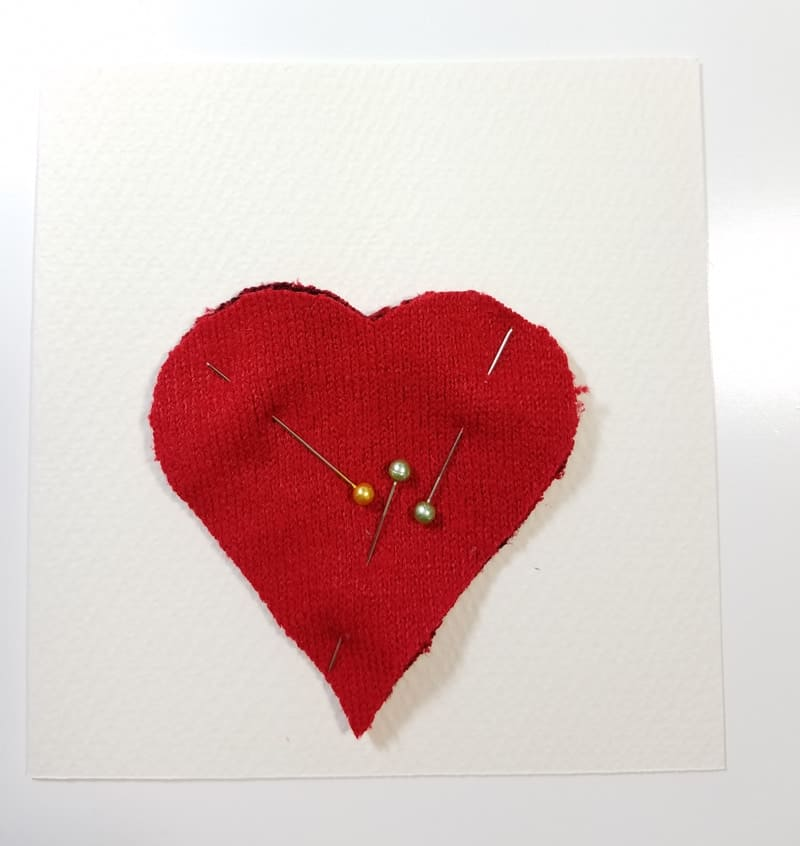 Heart shaped hand warmer made from a thrift store sweater