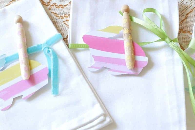 Plain white cloth napkins with watercolor paper bunnies, ribbons, and polka dot wooden clothespins