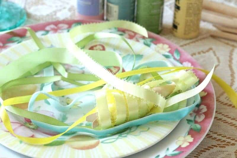 Various spring colored pastel ribbons on a Pfaltzgraff Grandma's Kitchen luncheon plate