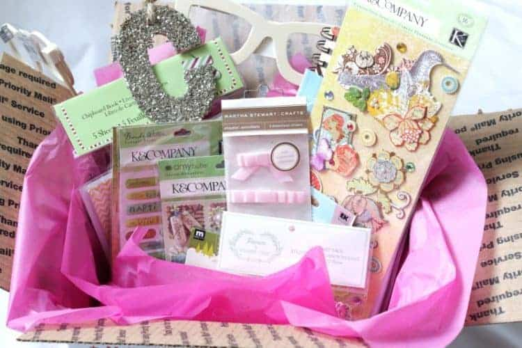Box of pretty craft supplies - shabby chic, paper craft, scrapbooking, and photo booth crafts.