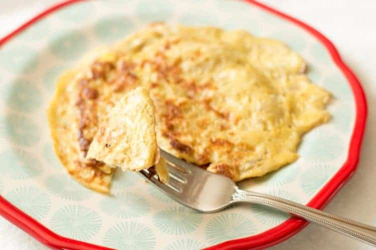Curb carb cravings with these 2-ingredient banana egg pancakes. Delicious and filling and totally okay for gluten-free and Paleo diets and lifestyles.