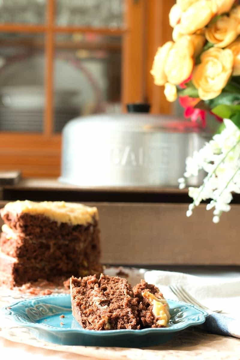 How to Make the Best German Chocolate Cake from Scratch - cake on plate, cake on platter and Grandma's cake pan lid