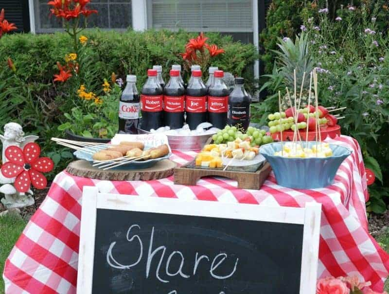 Outdoor entertaining table with food on sticks! Such an easy way to entertain with little cleanup and minimal waste.