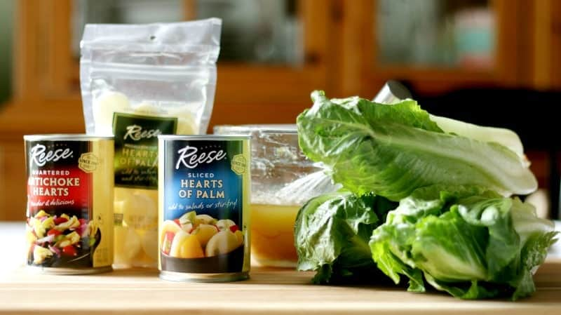 A delicious hearts of palm salad with artichoke hearts, romaine lettuce and a tangy citrus Dijon dressing.