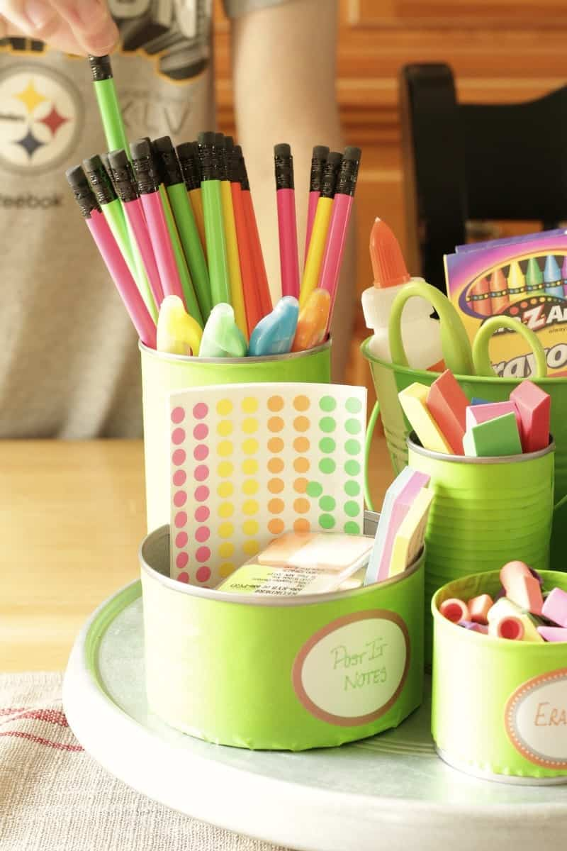 Organize back-to-school supplies and create a colorful homework station with items from the Dollar Tree and upcycled Tin Cans.
