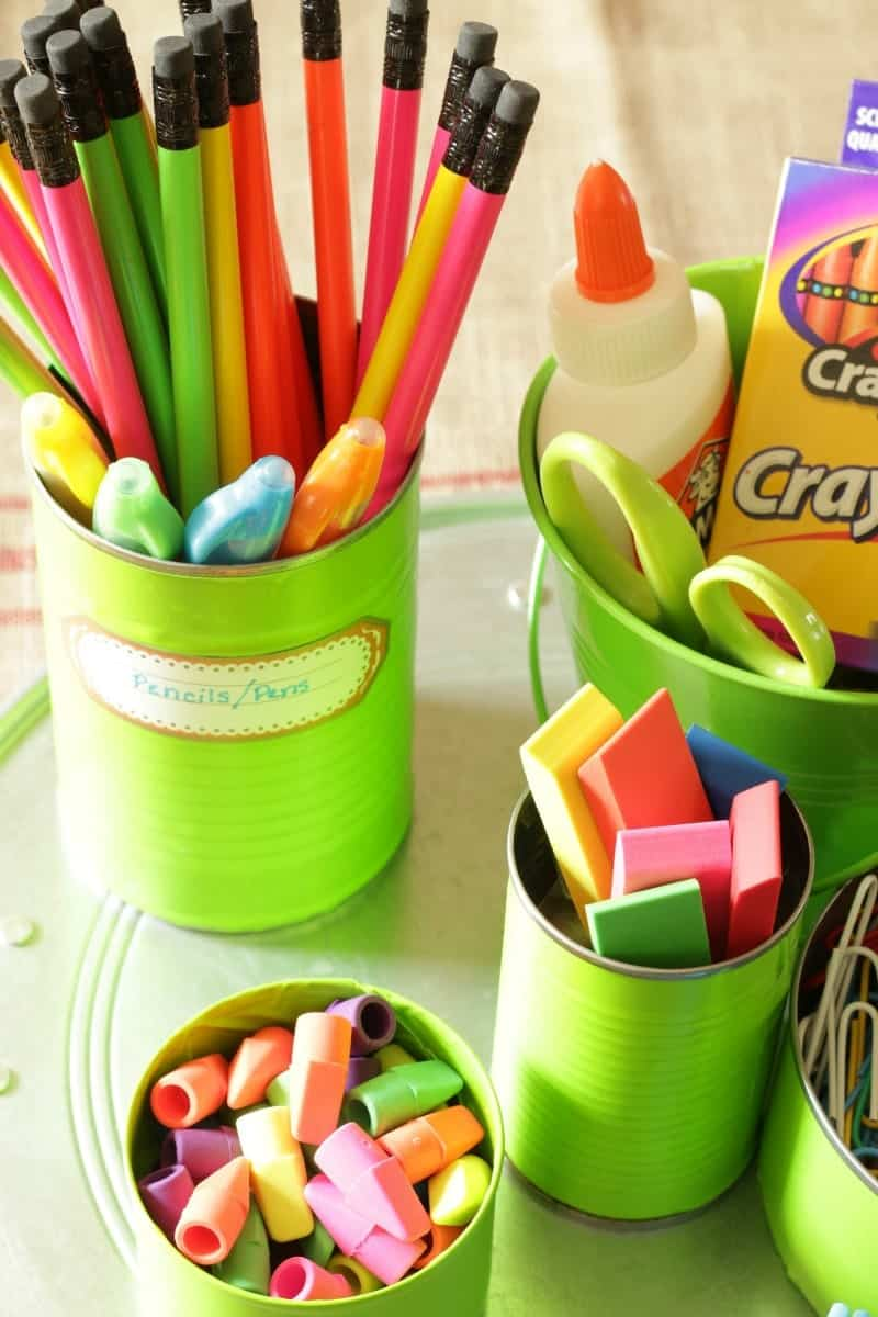 Organize back-to-school supplies with empty tin cans