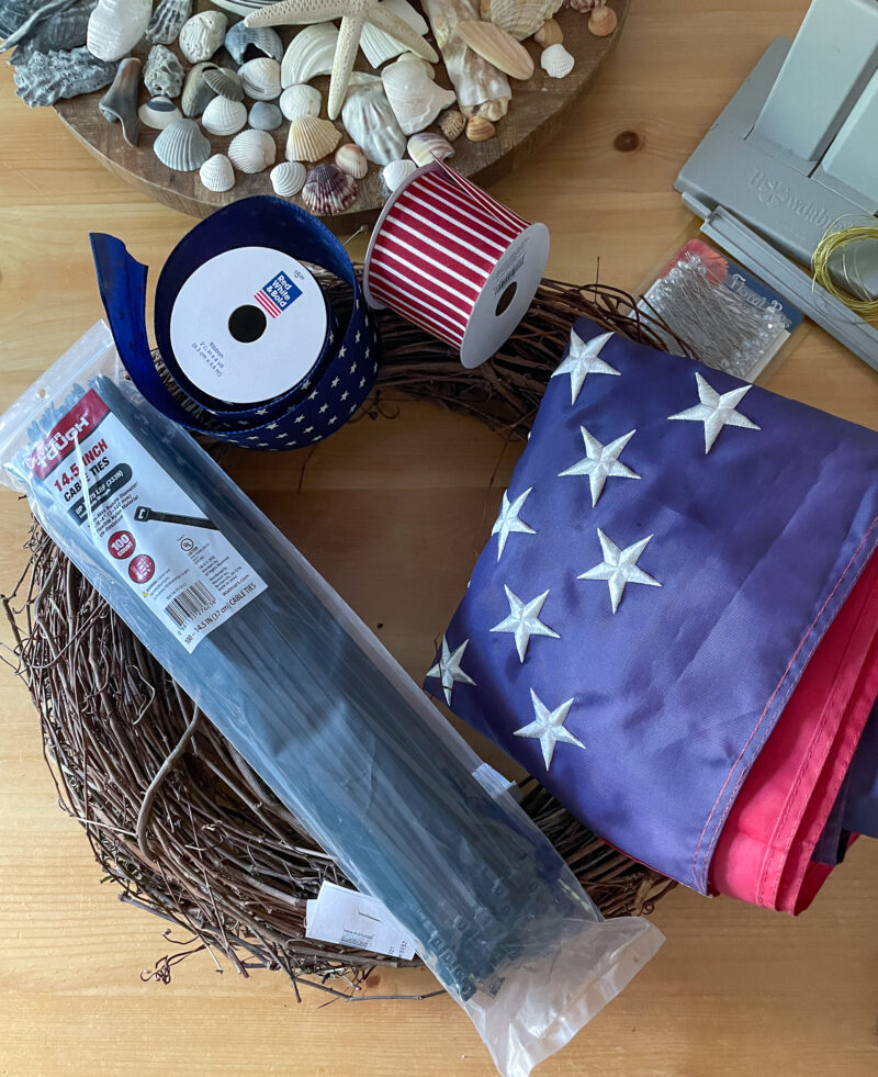 Overhead view of supplies used to make an American Flag Grapevine Wreath