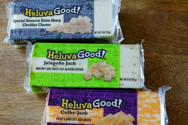 Heluva Good Cheese in Packages on Cutting Board