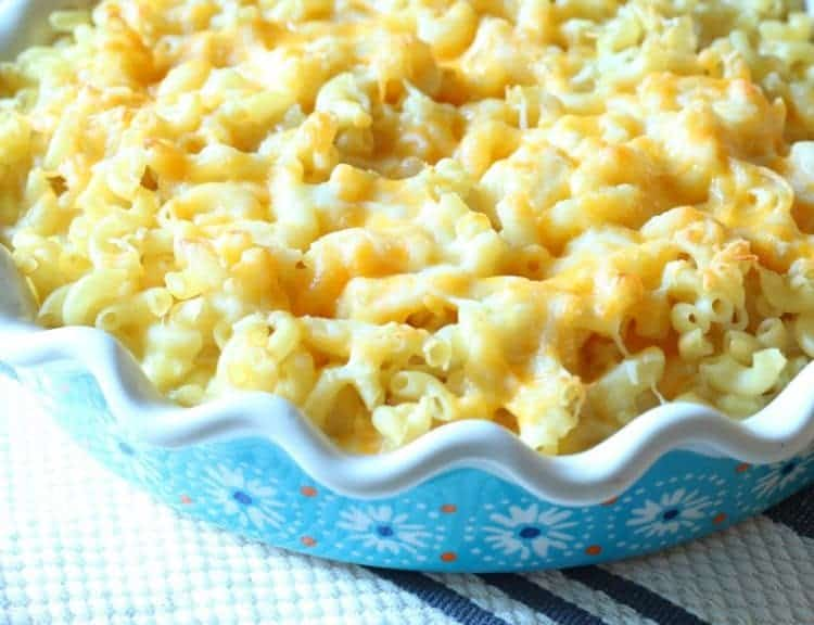 Homemade oven-baked macaroni and cheese fresh out of the oven in blue Pioneer Woman pie plate.