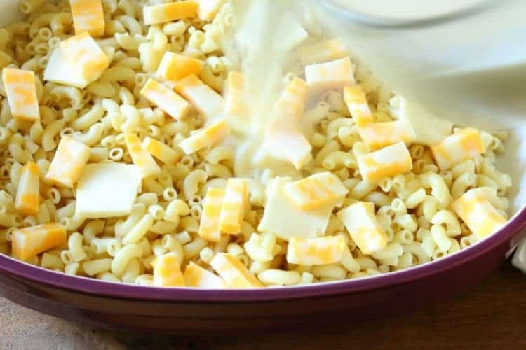 Homemade oven-baked macaroni and cheese - pour half of milk and egg mixture