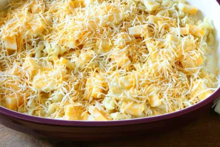 Homemade oven-baked macaroni and cheese - sprinkle with half of the shredded cheese