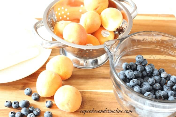 Colander of fresh apricots and blueberries ready for Apricot and Blueberry Cake - cupcakesandcrinoline.com