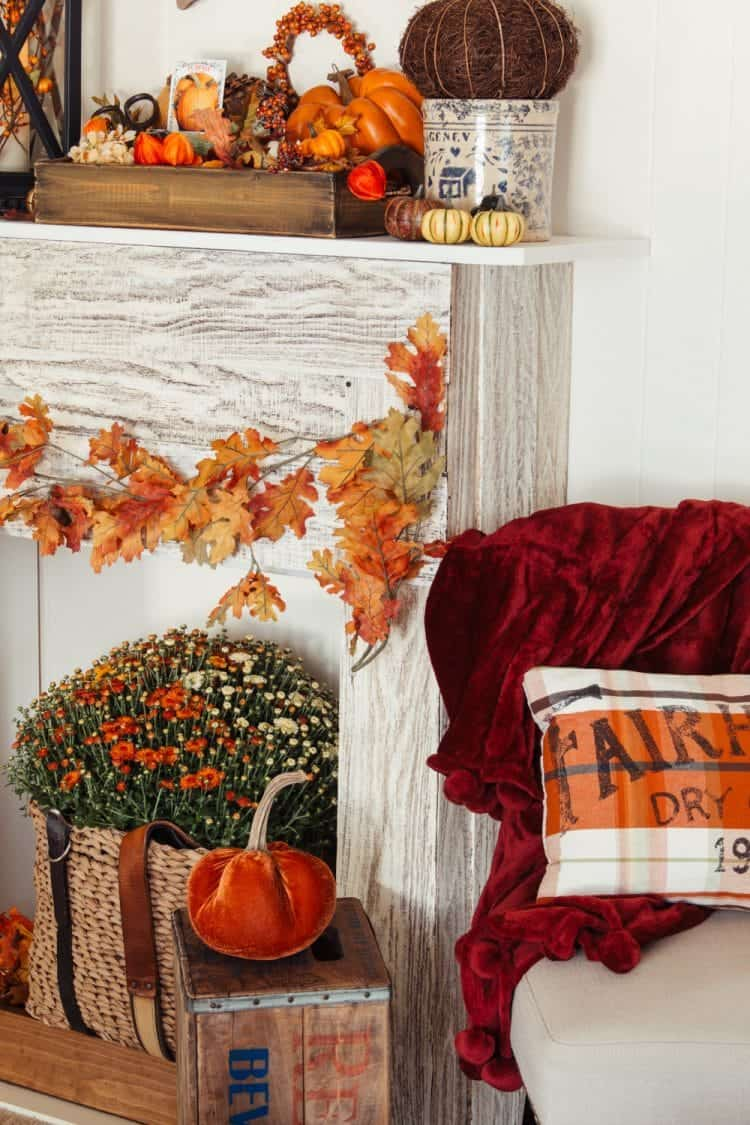 Fall decor - lots of oranges included a velvet pumpkin, a homemade pillow, mums, and lots more pumpkin stuff