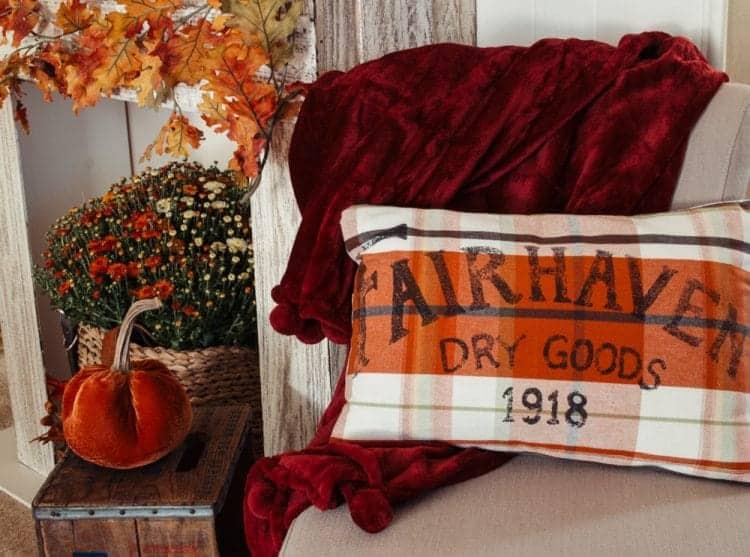 Kitchen towel pillow, red plush throw and orange velvet pumpkin